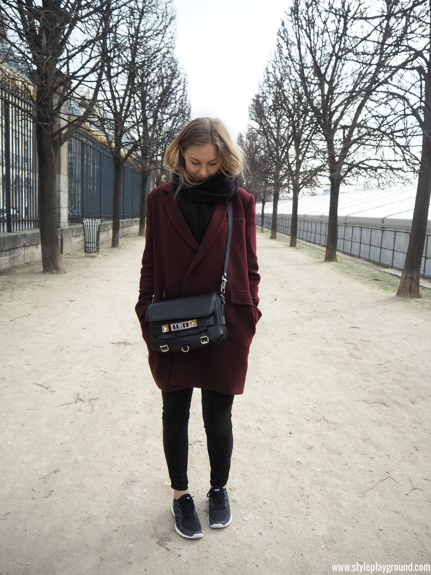 Axelle Blanpain of Style playground is wearing an Essentiel coat, American Eagle jeggings, Nike Free run sneakers & Proenza Schouler PS11 bag