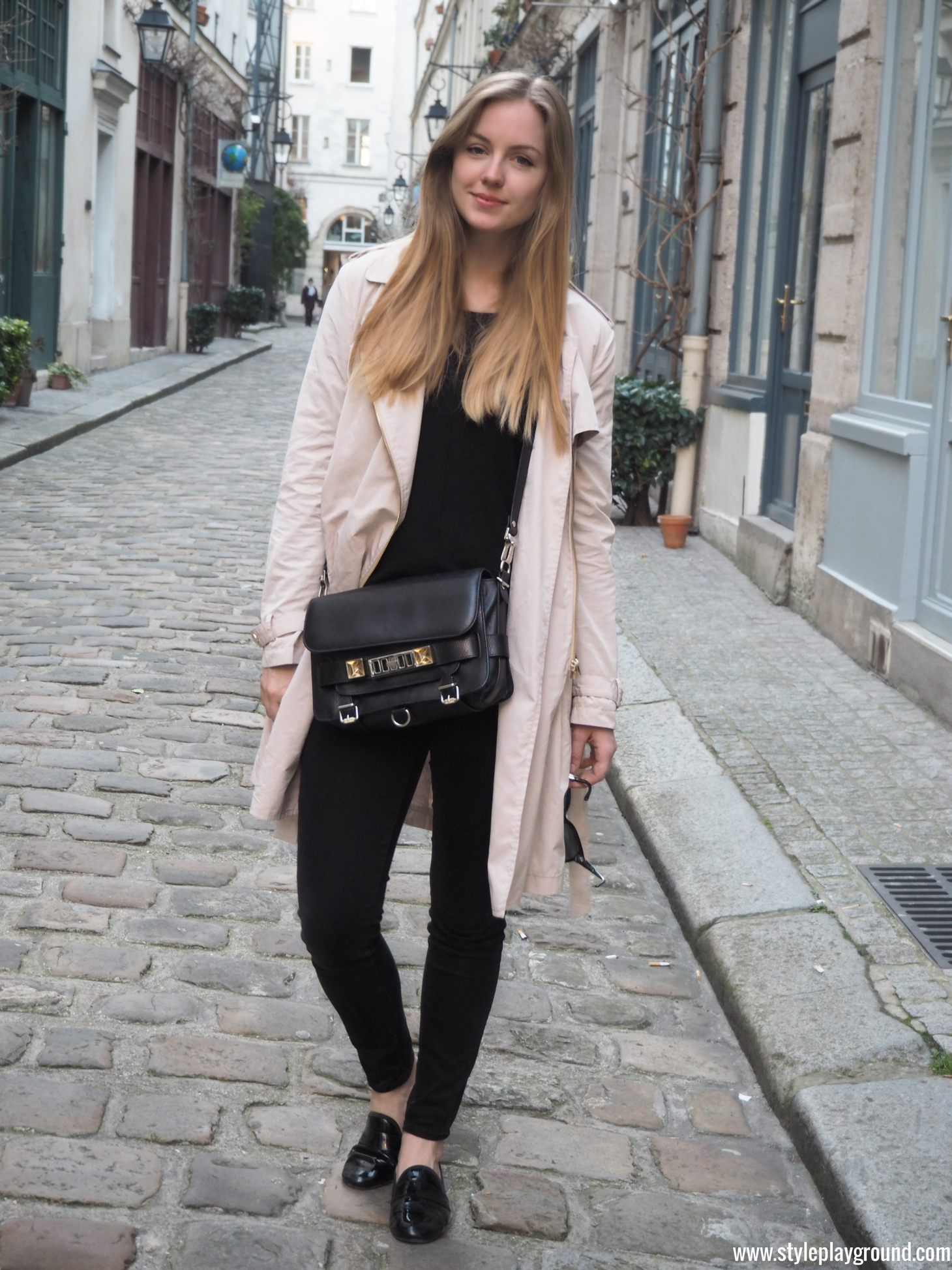 Axelle Blanpain of Style playground is wearing a Mango trench, J Brand skinny jeans, Repetto loafers & Proenza Schouler bag.