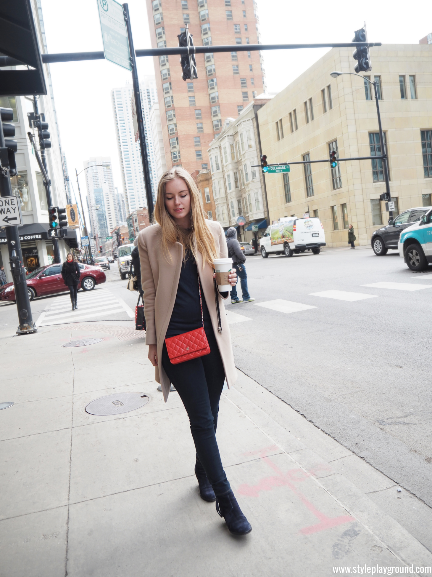 Axelle Blanpain of Style playground is wearing a Zara coat, Mango sweater, American Eagle jeggings, Acne Pistol boots & Chanel WOC