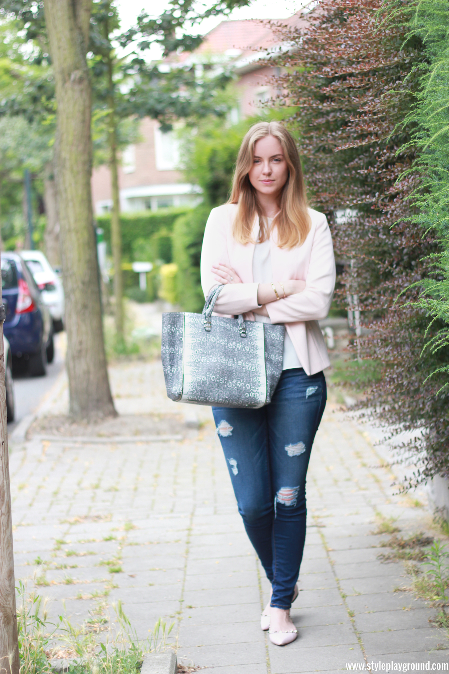 Axelle Blanpain from Style playground is wearing American Eagle ripped jeans, H&M blazer, Zara top, Rebecca Minkoff mini Perry tote & Valentino rockstud flats