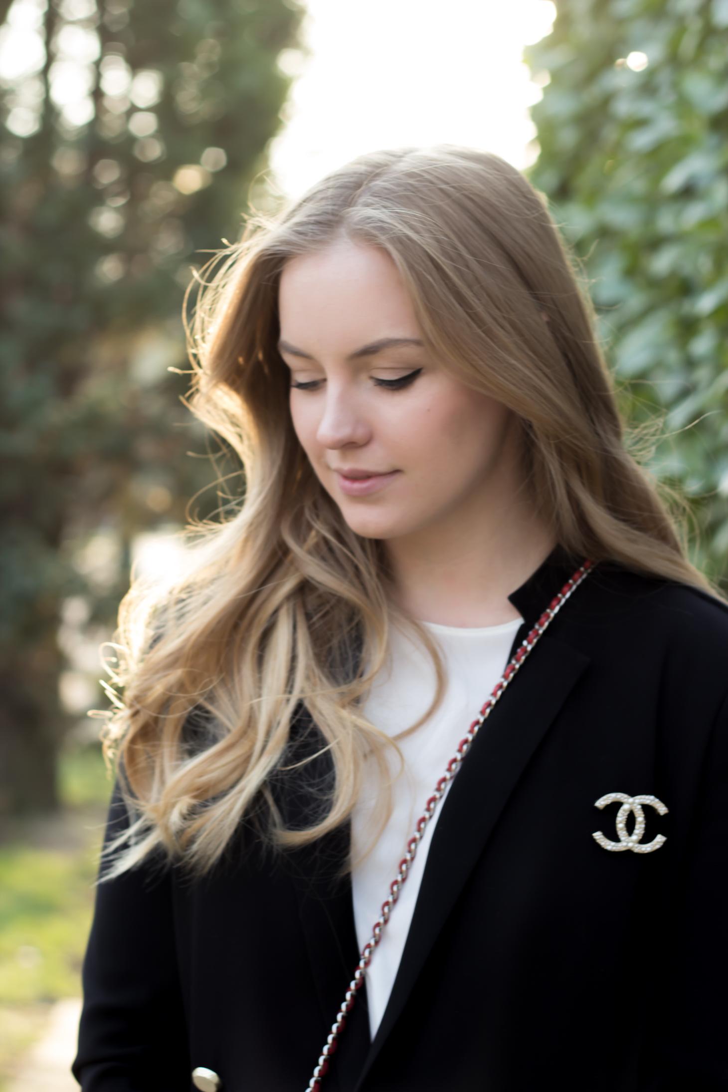 Black blazer + Chanel brooch